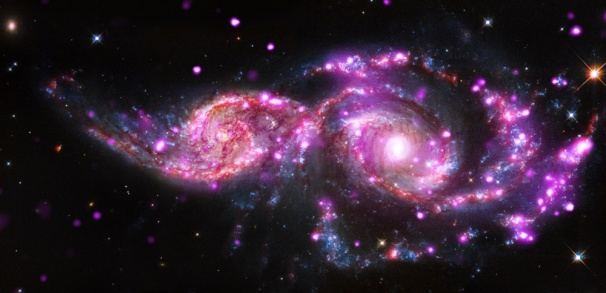 """NGC 2207 and IC 2163 are two spiral galaxies in the process of merging. They have hosted three supernova explosions in the past 15 years and have produced one of the most bountiful collections of super-bright X-ray lights known."""